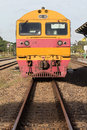 Front view of trains on railways track parking in railroads plat platform station Stock Photography