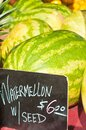 Watermelons for sale with price sign Royalty Free Stock Photo