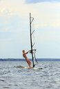 Front view of woman windsurfing Stock Images
