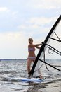 Front view of woman windsurfing Stock Photography