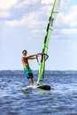 Front view of young windsurfer a passing by Stock Images