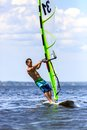 Front view of young windsurfer a passing by Royalty Free Stock Image