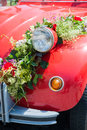 Front of a wedding car red with flower bouquet Stock Image