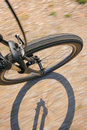 Front wheel of a bike on a dirt road Royalty Free Stock Photo