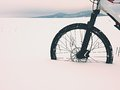 The front wheel of mountain bike stay in powder snow. Lost path Royalty Free Stock Photo