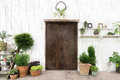 Front wood door and garden decor in white cosy house or cottage. Royalty Free Stock Photo