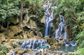 Frontal view of the spectacular waterfalls near luang prabang in laos Stock Photo
