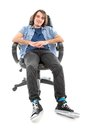 Frontview of lazy man sitting stretched out in an armchair isolated over white Royalty Free Stock Photography