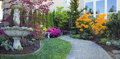 Frontyard landscaping with paver walkway water fountain and brick pavers path azalea flowers in bloom Stock Photography