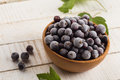Frosen blackberries in bowl frozen blackcurrants wooden on white wooden table selective focus Stock Photography