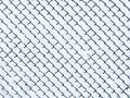 Frost on chain link fence snow covered Royalty Free Stock Photo
