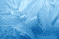 Frost patterns on window glass in winter. Frosted Glass Texture. Blue Royalty Free Stock Photo