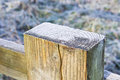 Frost on top of a wooden fence post Royalty Free Stock Photo
