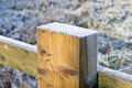 Frost on top of a wooden fence post Stock Photos