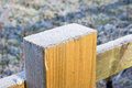 Frost on top of a wooden fence post Stock Photography