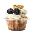Frosted cupcake with sugared blueberries, isoleted on white Royalty Free Stock Photo