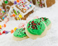 Frosted holiday cookies for the season of joy close up photo sugar christmas with gingerbread houses surrounded by powered snow in Royalty Free Stock Images