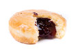 Frosted jelly filled donut with a bite out of it Royalty Free Stock Photo