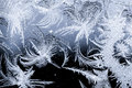 Frosted winter ice crystals on glass close up of traditional crystal patterns a clean background Stock Photo