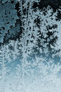 Frosty pattern on window glass Stock Photos