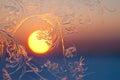 Frosty patterns window pane sunset focus center Royalty Free Stock Photos