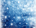 Frosty winter pattern glowing at a window glass macro texture Royalty Free Stock Images
