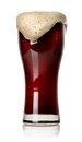 Froth on black beer in glass isolated white Royalty Free Stock Photography