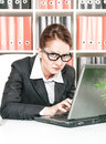 Frown business woman working with laptop Stock Photos