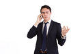 Frowning young caucasian business man holding a mobile phone male businessman frowns with raised hand while looking away from Stock Photo
