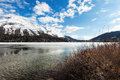 Frozen alpine lake beautiful mountain landscape Stock Photo