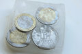 Frozen assets greek euro and drachme coins in ice Stock Photo