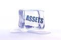 Frozen assets the word inside an ice cube Stock Photo