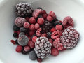 Frozen berries in a white bowl Stock Photos