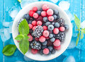 Frozen berry top view on turquoise background Stock Photography