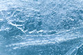 Frozen blue ice surface texture, icy xmas background. macro view, soft focus Royalty Free Stock Photo