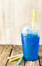 Frozen Blue Slushie in Plastic Cup with Straw Royalty Free Stock Photo