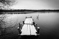 Frozen bridge in monochrome monochromatic landscape with on swedish lake Royalty Free Stock Photography
