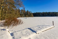 Frozen bridge on swedish lake beautiful natural landscapes in winter season Royalty Free Stock Photo