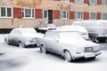 Frozen cars novyy urengoy russia october and covered by snow motor at the city street Stock Photography