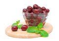 Frozen cherries and mint  on white background Royalty Free Stock Photo