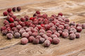 Frozen cherries on a wooden table Royalty Free Stock Photo