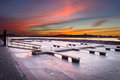 Frozen dock on sunset boat seaside landscape Stock Image