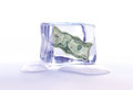 Frozen dollar assets money banknote inside an ice cube Stock Images