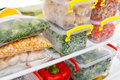 Frozen food in the refrigerator. Vegetables on the freezer shelves. Royalty Free Stock Photo