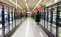 Frozen foods aisle in a supermarket Stock Images