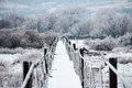 Frozen footbridge beautiful winter landscape with Stock Photos
