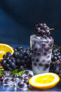 Frozen grapes in ice with orange close-up Royalty Free Stock Photo