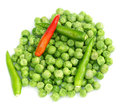 Frozen green peas with chilies on white background Royalty Free Stock Photo