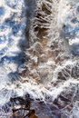 Frozen ice under melting snow stream crystals in spring forest Royalty Free Stock Images