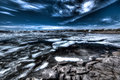 Frozen lake in stormy night along the road hardangervidda plateau under a sky by norway Royalty Free Stock Photography